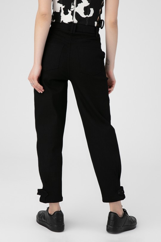 DENIM TROUSERS WITH POCKETS ON THE SIDES
